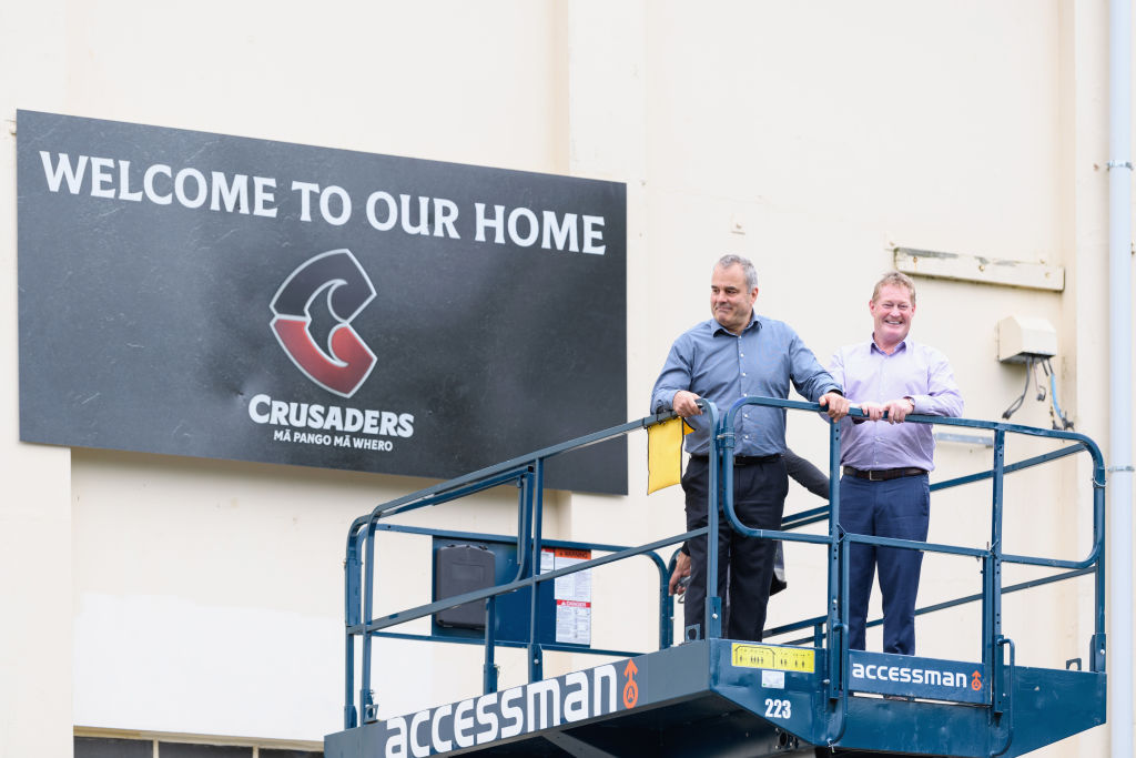 Crusaders CEO Colin Mansbridge (L) and Chairman Grant Jarrold pose in front of the new logo at...