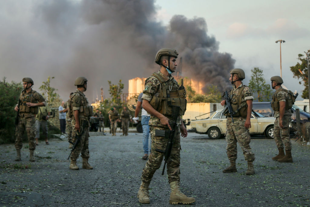 Lebanese soldiers stand guard near the site of the explosion in Beirut's port. Photo: Getty Images
