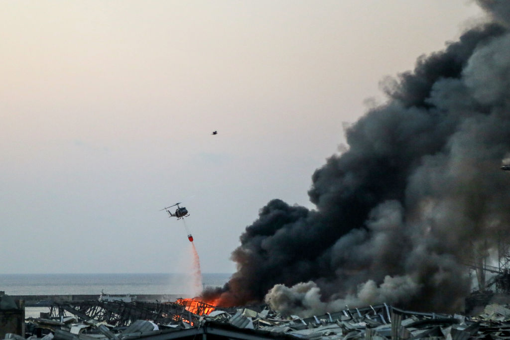 A military helicopter fights the fire following the explosion in Beirut's port. Photo: Getty Images