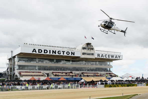 Richie McCaw delivers the New Zealand Trotting Cup in his helicopter. Photo: Getty Images