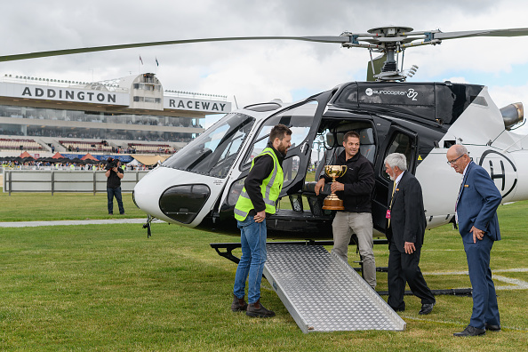Richie McCaw delivers the New Zealand Trotting Cup in his helicopter. Photo: Getty