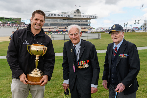 Richie McCaw delivers the New Zealand Trotting Cup alongside war veterans Neil Harton and Jack...