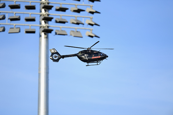 A rescue helicopter next to one of the new floodlights during the Super Smash T20 match between...