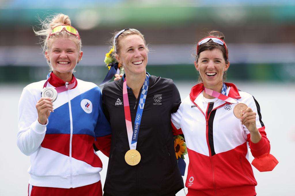 Gold medal winner Emma Twigg, of New Zealand (centre), is flanked by Team ROC's Hanna Prakatsen ...