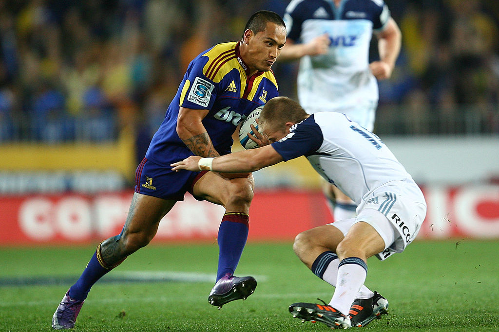 Hosea Gear runs over Gareth Anscombe during his devastating display which sparked a Highlanders...