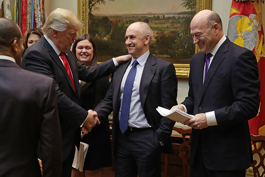 US President Donald Trump (L) with Chris Liddell (C) in 2017. Photo: Getty