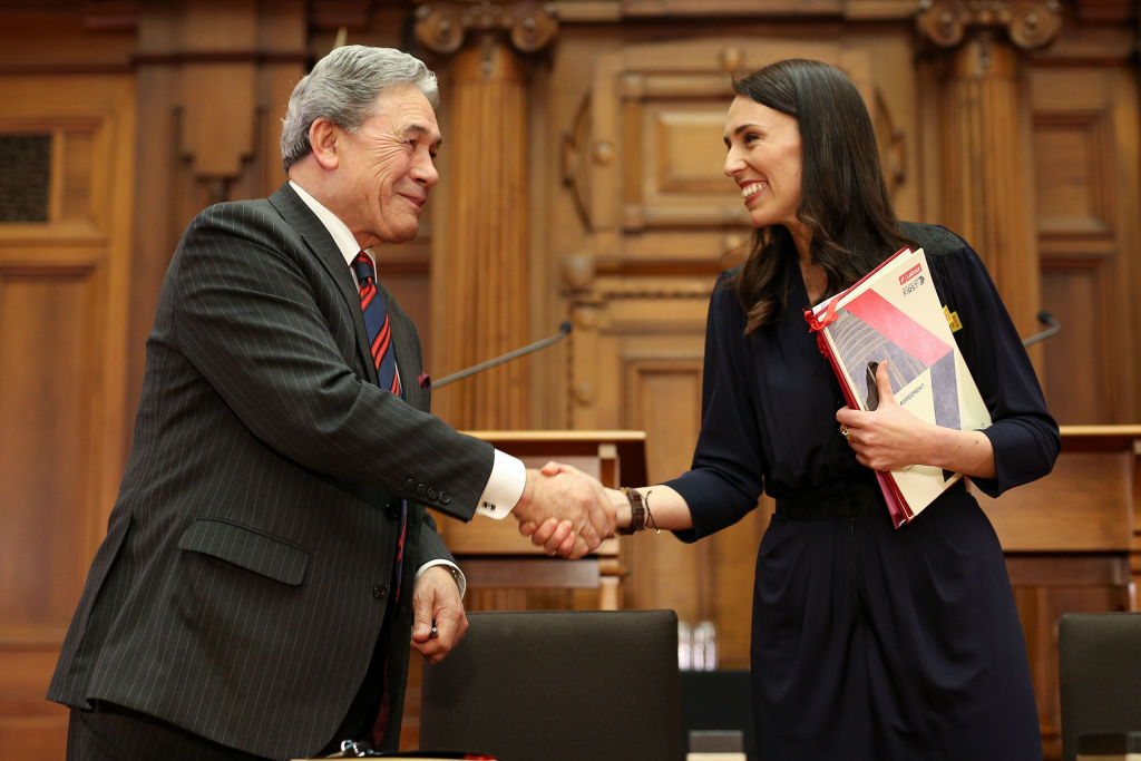 Labour leader Jacinda Ardern and NZ First leader Winston Peters shake hands during a coalition...