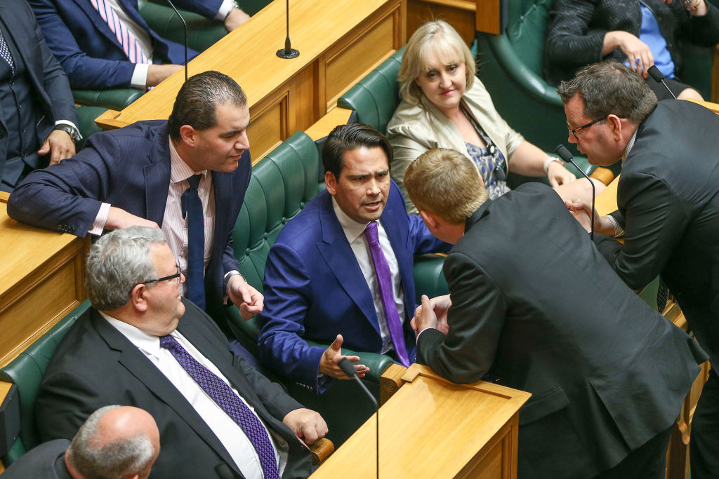 National MP Simon Bridges (seated, centre) speaks to Labour MP Chris Hipkins during the Opening...