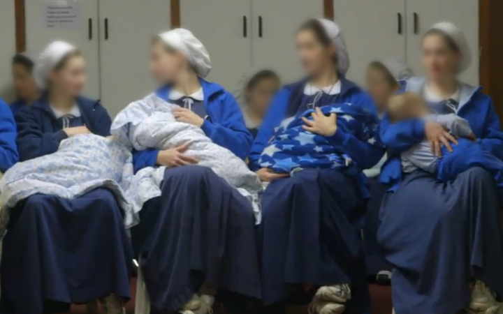 Mothers and children from the West Coast Christian community Gloriavale. Image: TVNZ via RNZ