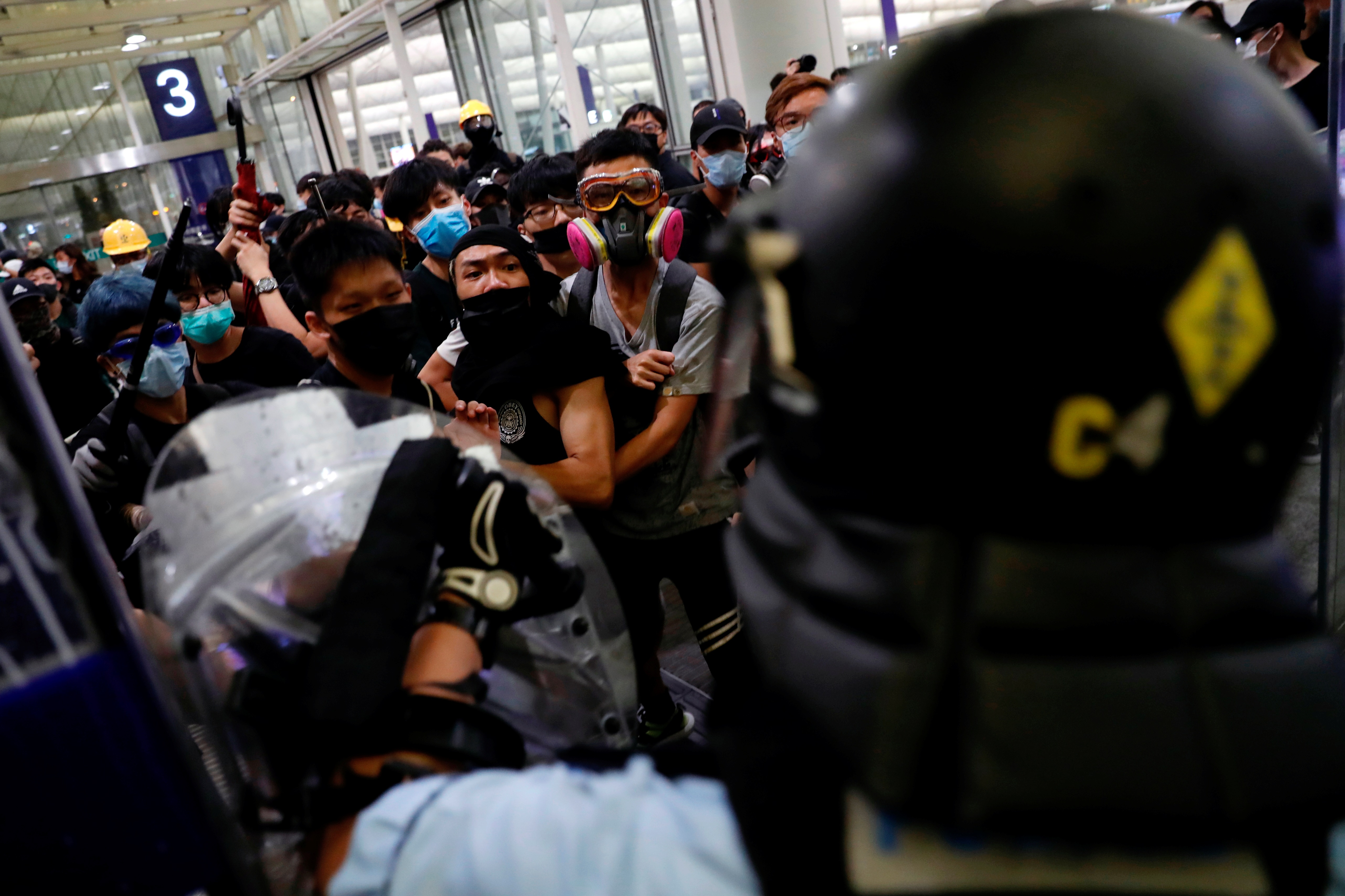 Anti-extradition bill protesters face riot police during a mass demonstration at the Hong Kong...