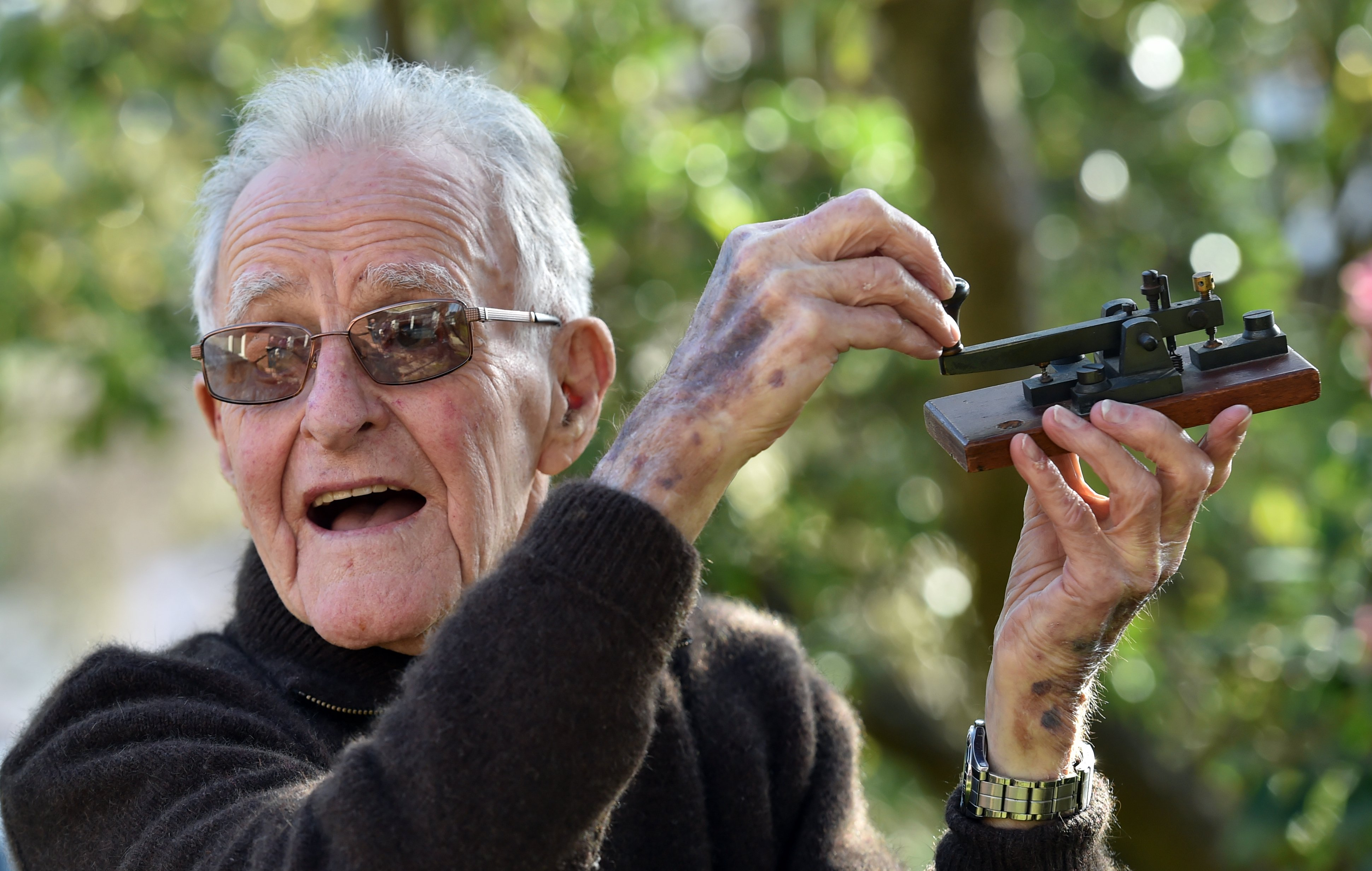 Former telegraph branch manager, Iain Graham (94), of Dunedin, with a Morse key of the type he...