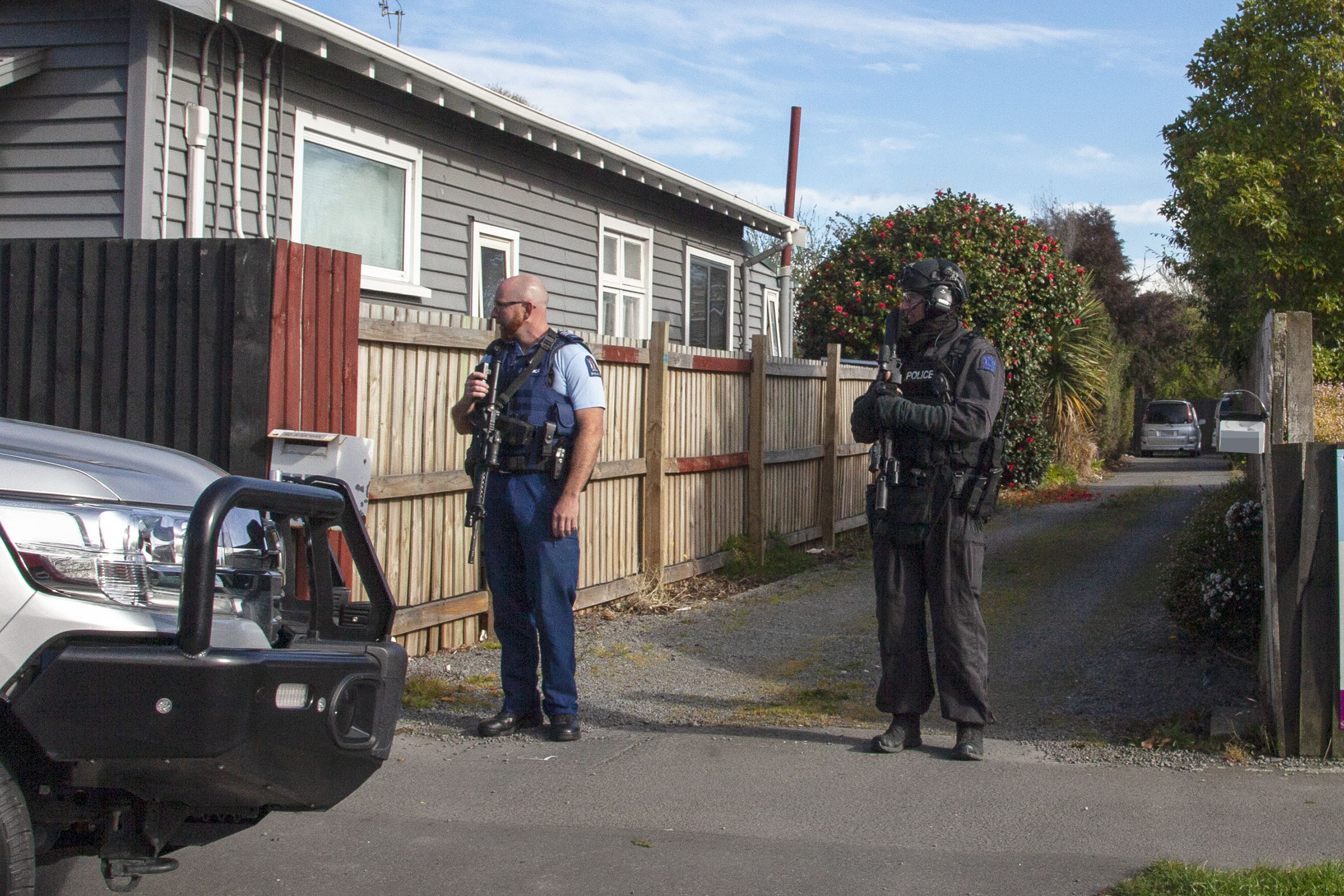 Police and a member of the AOS on Buckleys Rd. Photo: Geoff Sloan