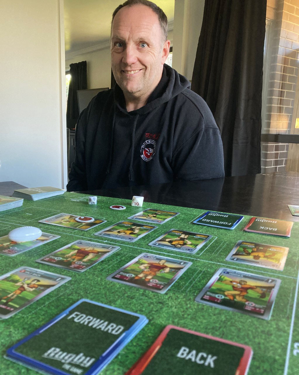 Zane Thompson has created a rugby board game. Photo: Chris Barclay