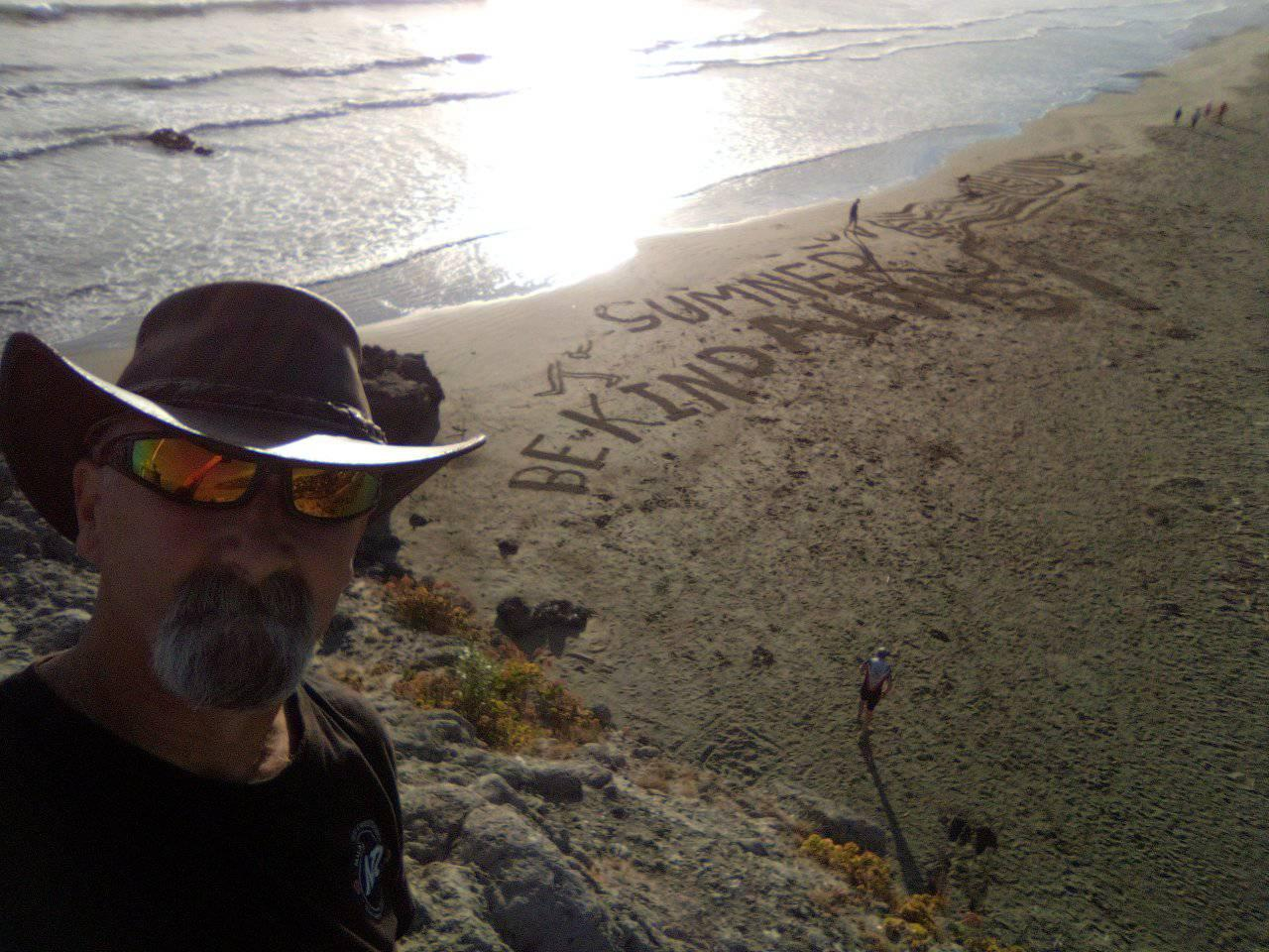 Webb spends hours creating unique murals in the sand; his purpose - just to make people smile....
