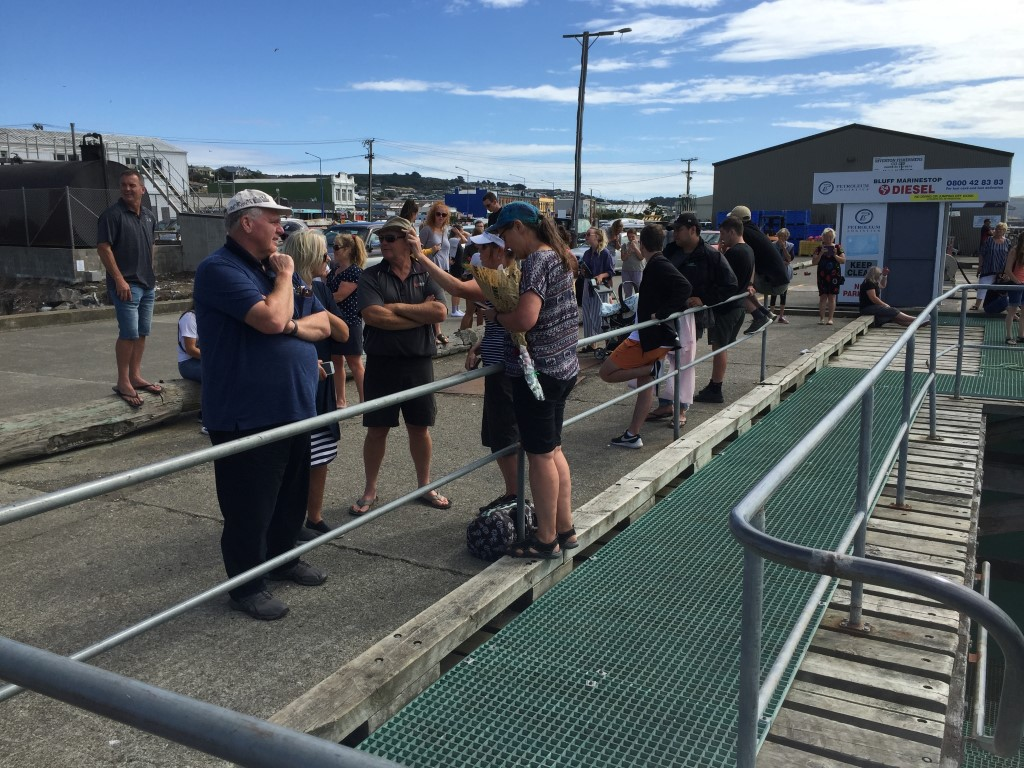 Supporters and family waiting for Hannah Morgan to arrive at the Bluff ferry terminal. Photo:...