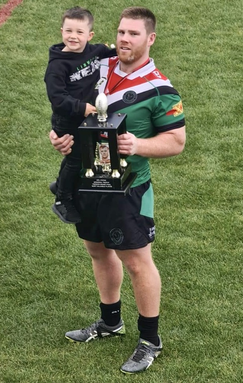 Linwood Keas stalwart Alex Todd - with son Izaac after the Canterbury Rugby League premiership...