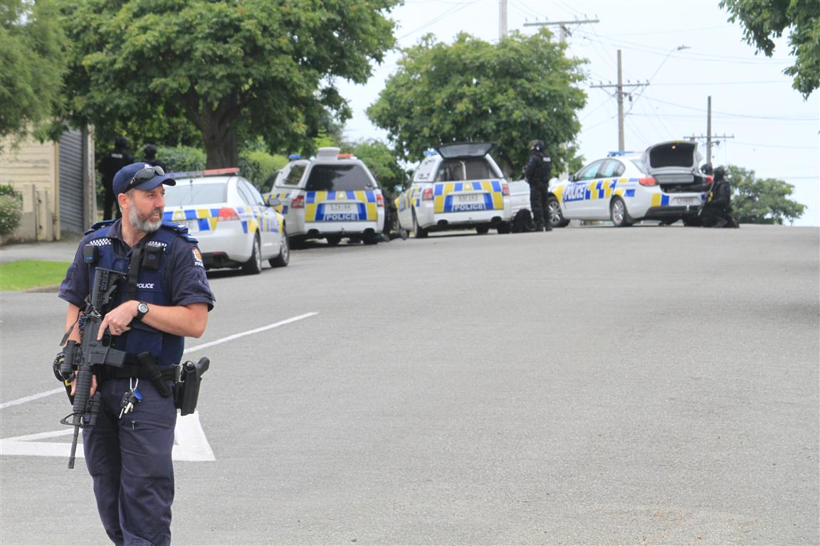 Armed police surround a Hull St address this morning. Photo: Hamish MacLean