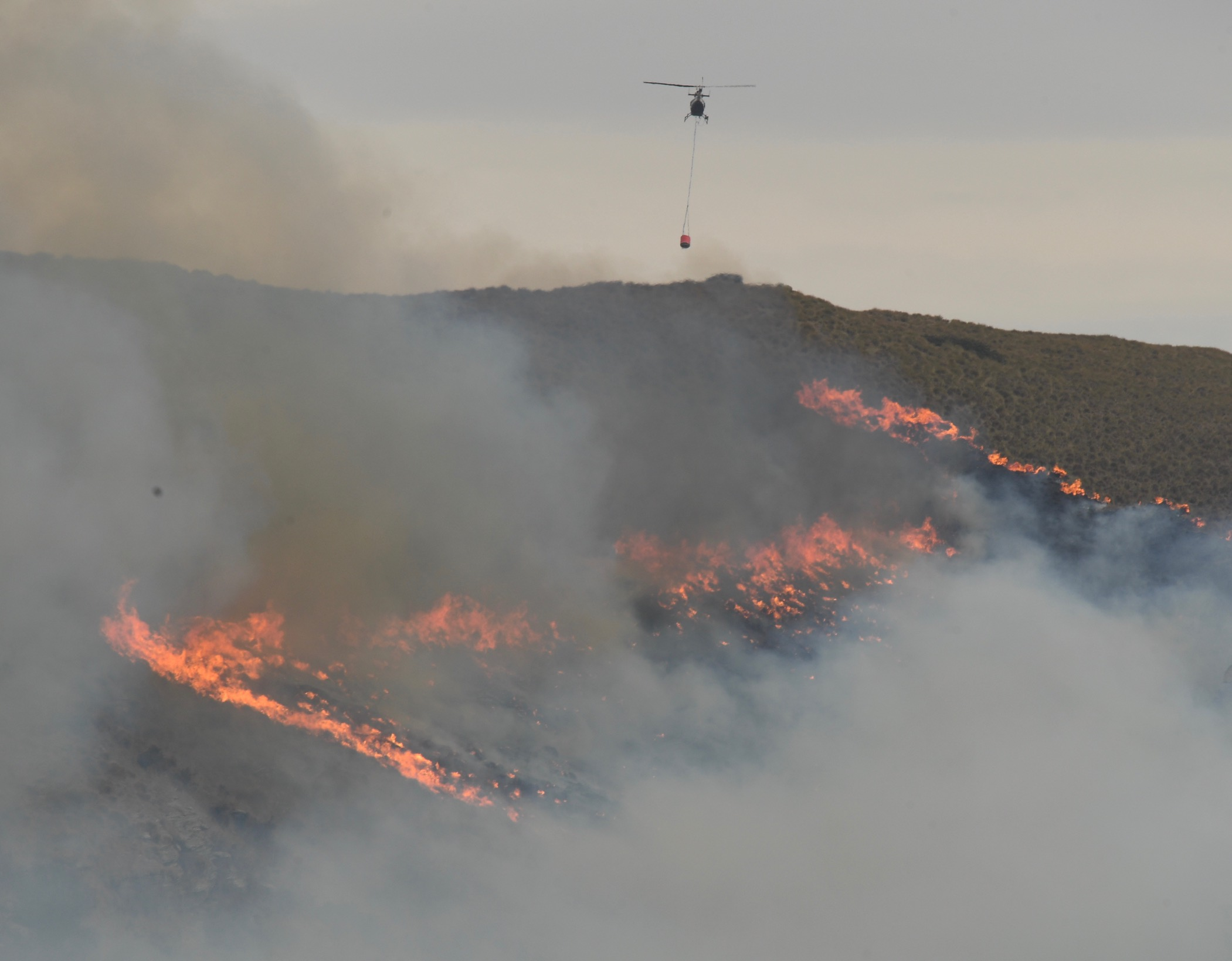 Seven helicopters were battling the fire at one stage. Photo: Stephen Jaquiery