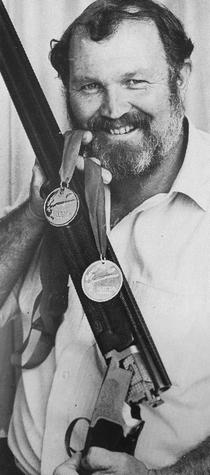 McCombe in 1990 with clay target shooting medals. Photo: Supplied
