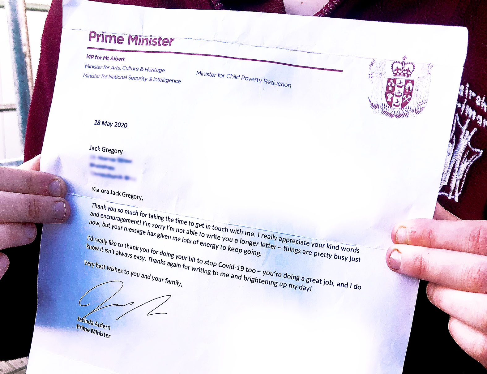 Jack with Ardern's letter. Photo: Bea Gooding