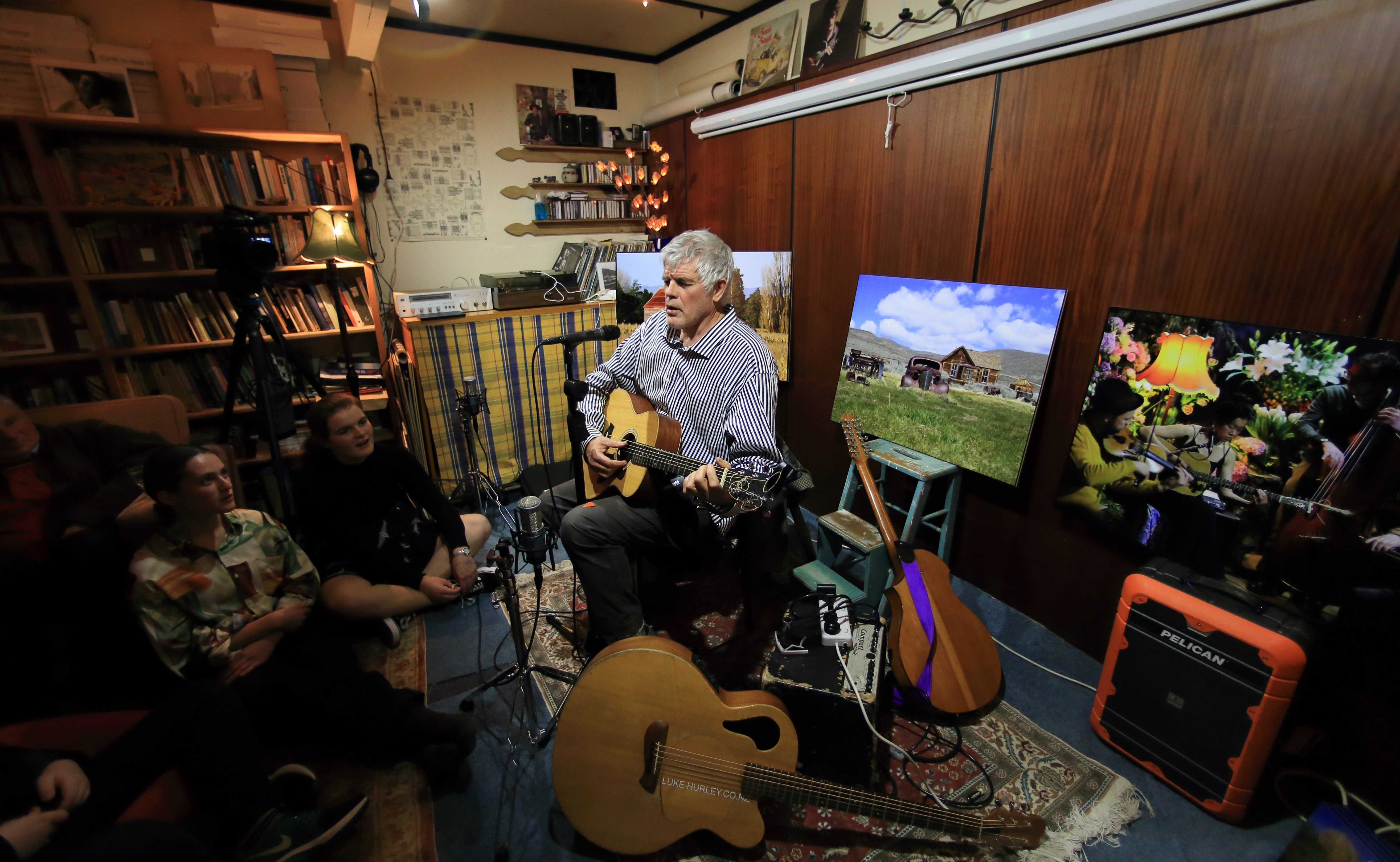 Luke Hurley plays a living room concert. Photo: Mark Thompson