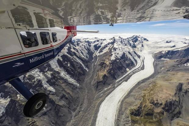 High above one of New Zealand's most famous glaciers - The Tasman. Since 1990 the ice has...