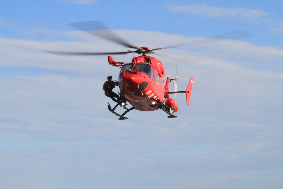 An Otago Rescue Helicopter crew member is hoisted back on board after leaving the water during...