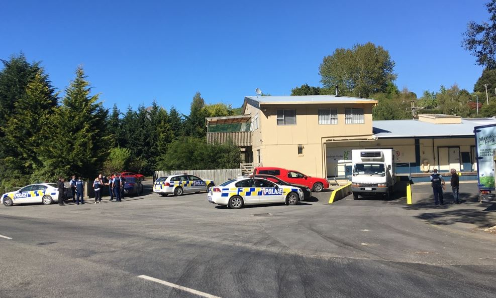 Armed offenders squad members were involved in a raid on an Oamaru address this morning. Photo:...