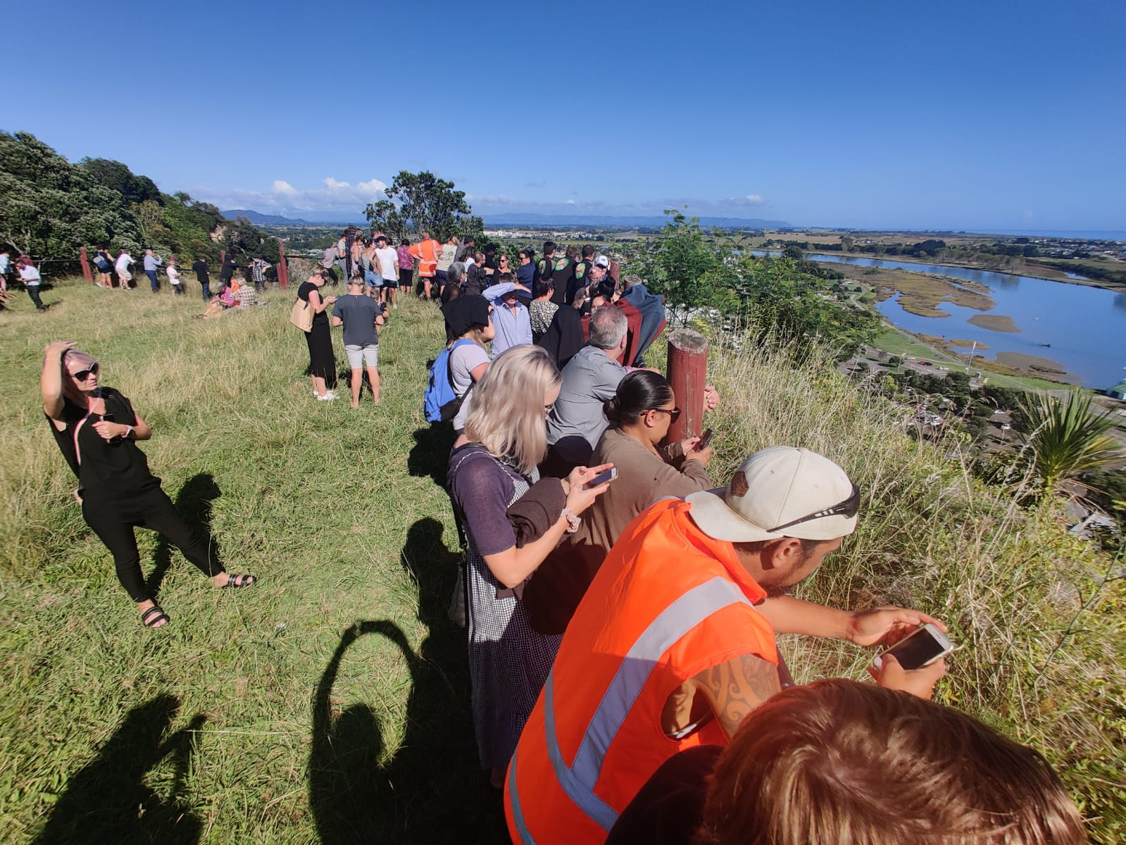 Whakatane residents congregated on high ground earlier today, including at Puketapu Lookout close...