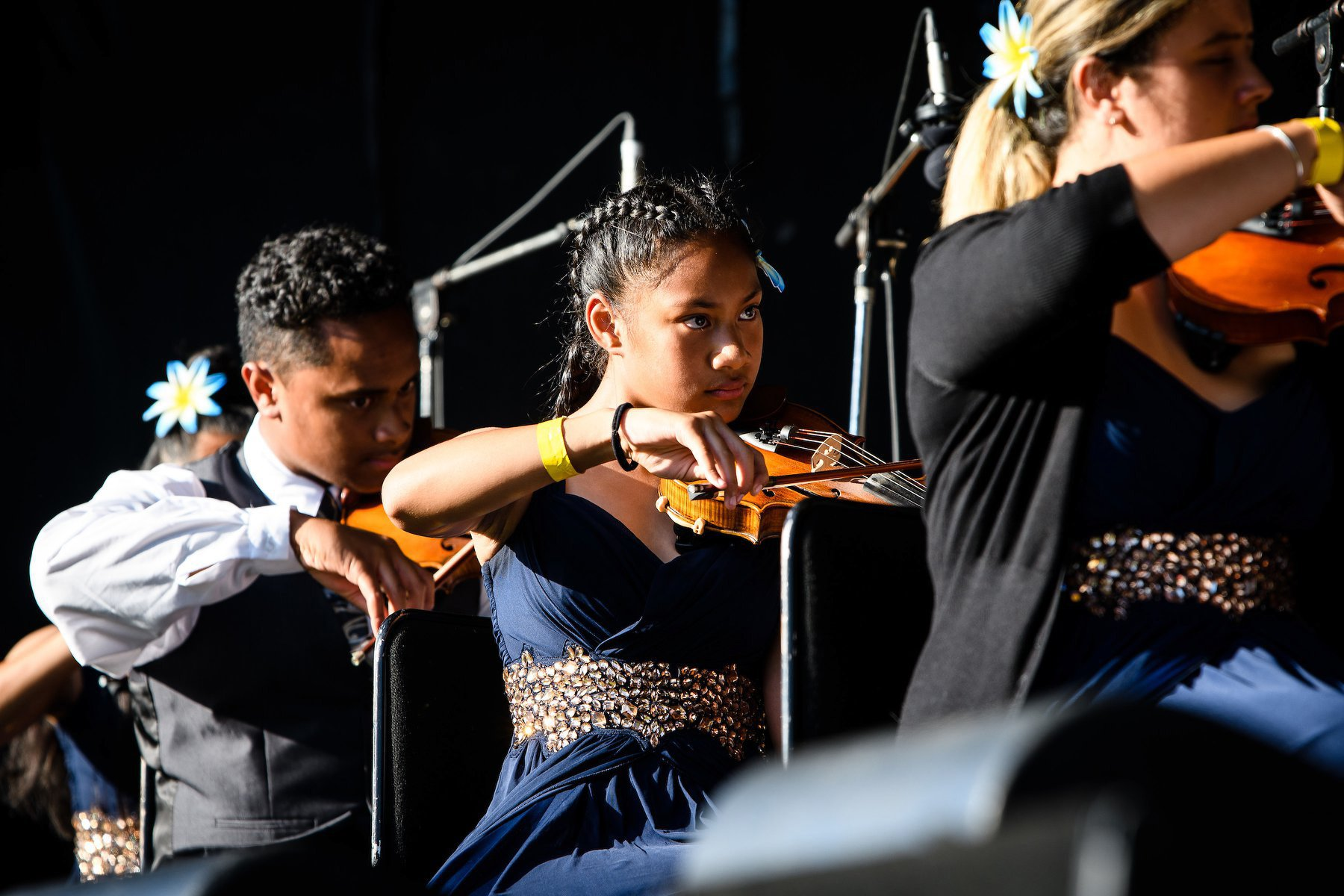 Members of the Virtuoso String Orchestra (from left) Toloa Faraimo, Rochelle Pese Akerise and...