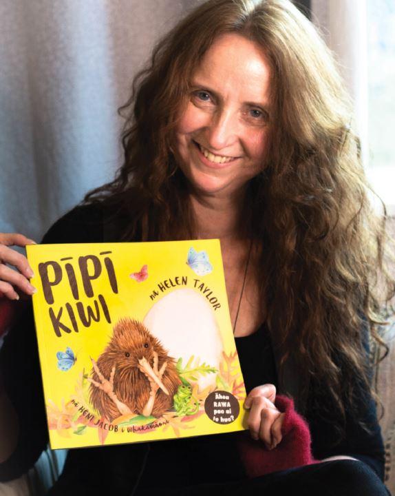 Helen Taylor with her children's book, Pīpī Kiwi. Photo: Supplied