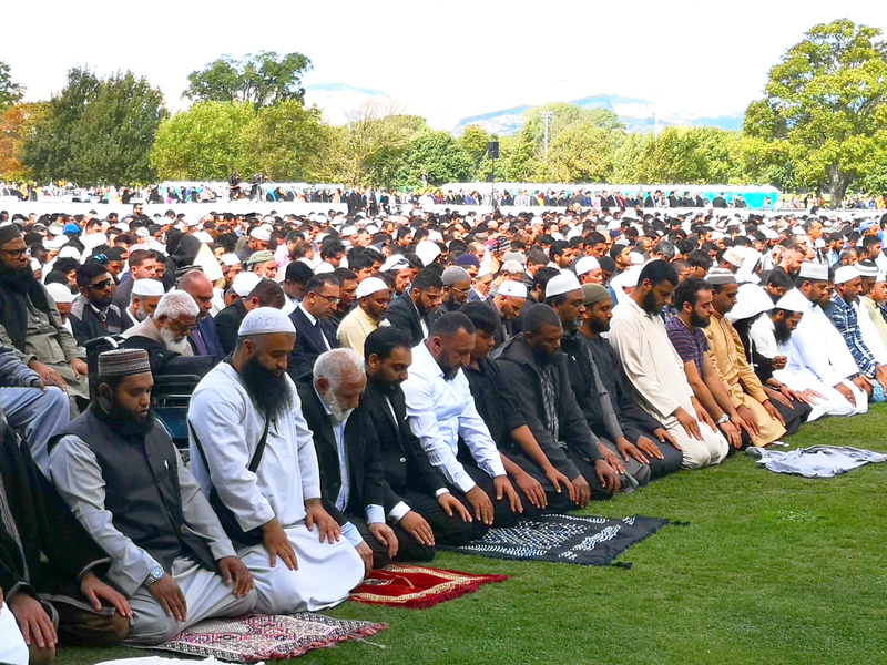 The mourners at Hagley Park in Christchurch during prayers on Friday. Photo: NZ Herald