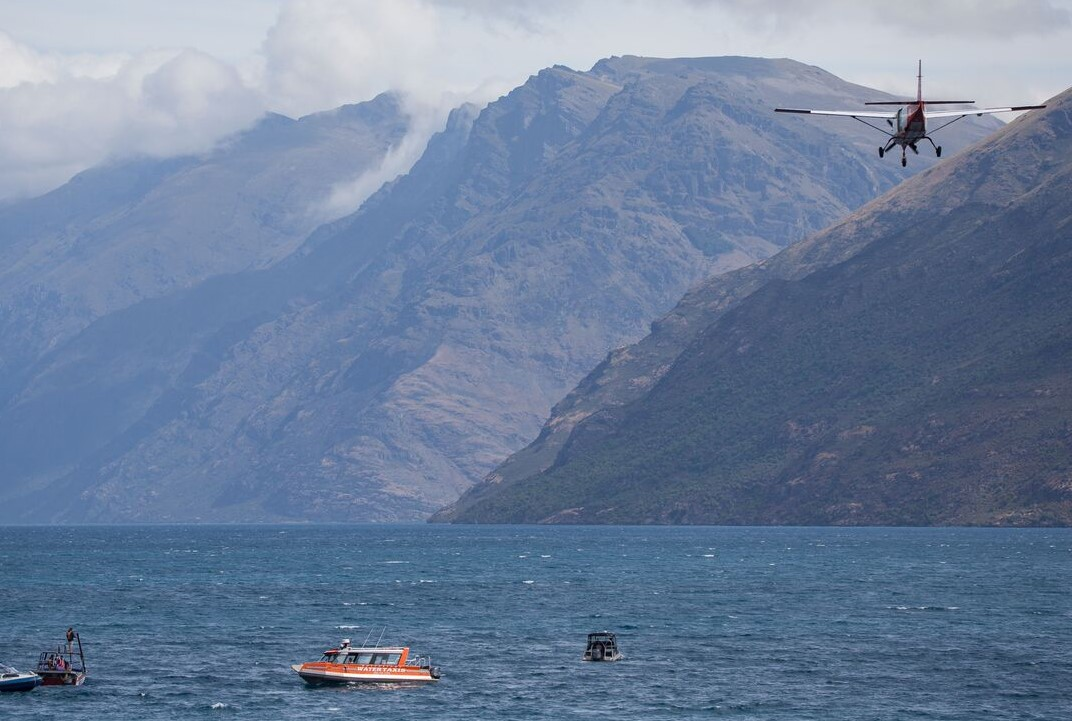 Searchers scour Lake Wakatipu for the missing skydiver. Photo: James Allan Photography