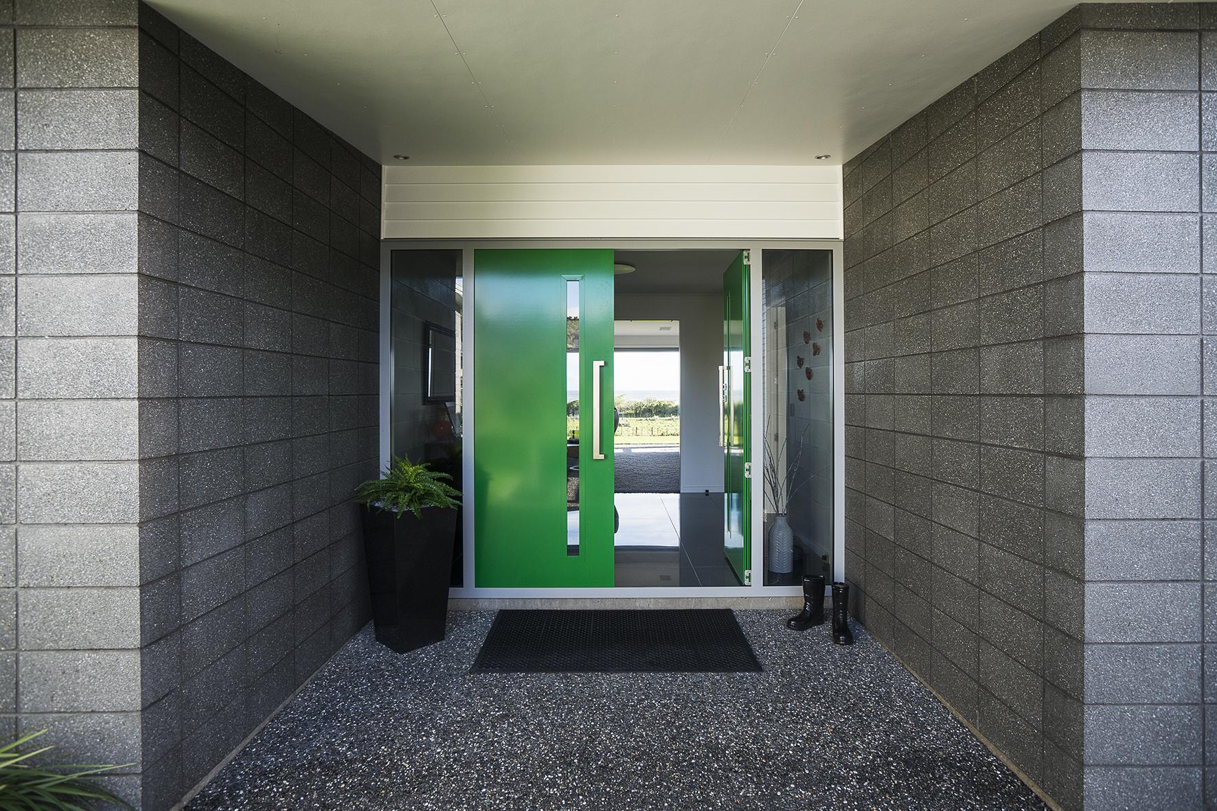 Front door in bold green Resene Camarone.  Project by Robert Caldana Builder.  Photo by Stewart...