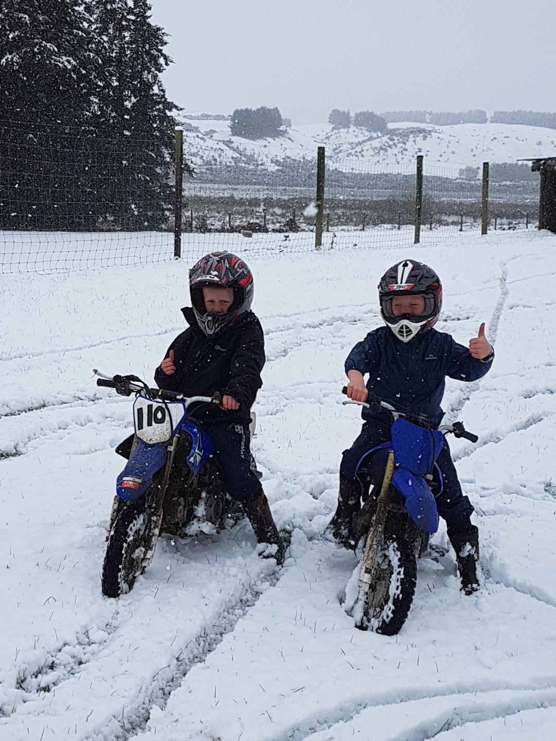 Brothers Logan (6, left) and Toby (8) Porteous tried out their snow wheels on their parents' farm...