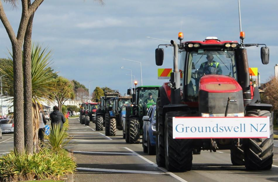 Tractors drive along Yarrow St in Invercargill during Howl of a Protest. PHOTO: LUISA GIRAO