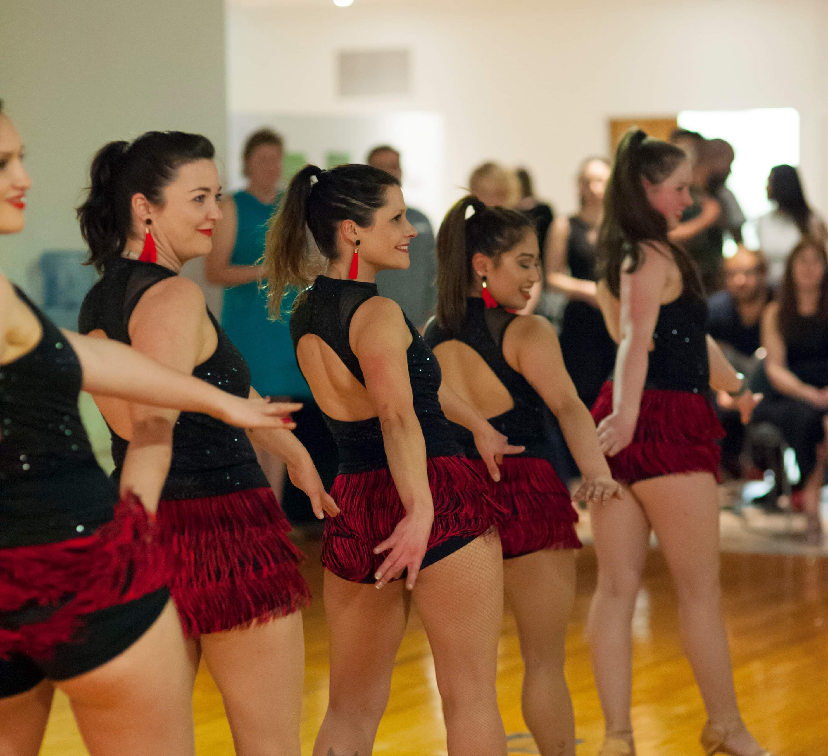 Salsa Club Dunedin's ladies team performing a vibrant and flamboyant Cha Cha routine.