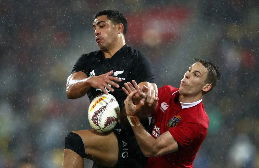 Liam Williams of the Lions and Anton Lienert-Brown of the All Blacks scramble for the ball. Photo...