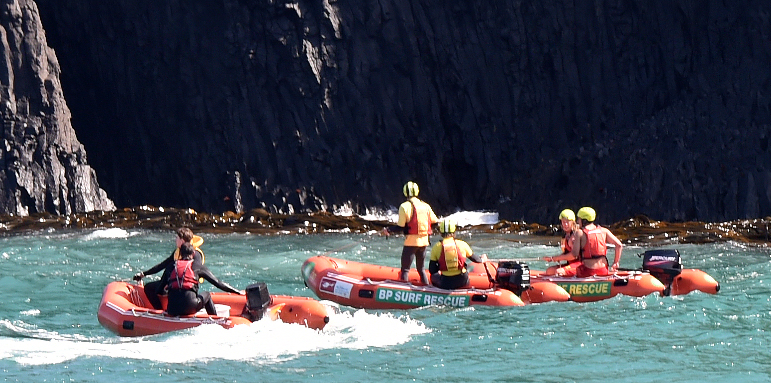 Lifesavers using inflatable rescue boats searched an area near the St Clair Hot Salt Water Pool....