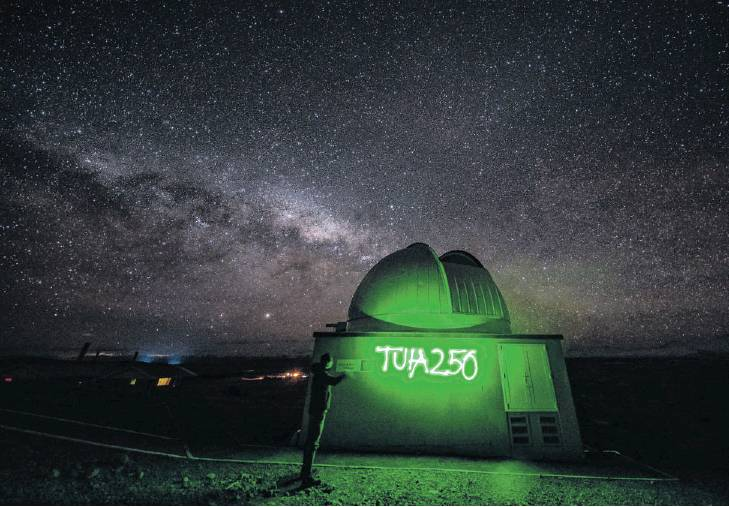 A high-school pupil at the University of Canterbury's Mt John Observatory marks the Ministry for...