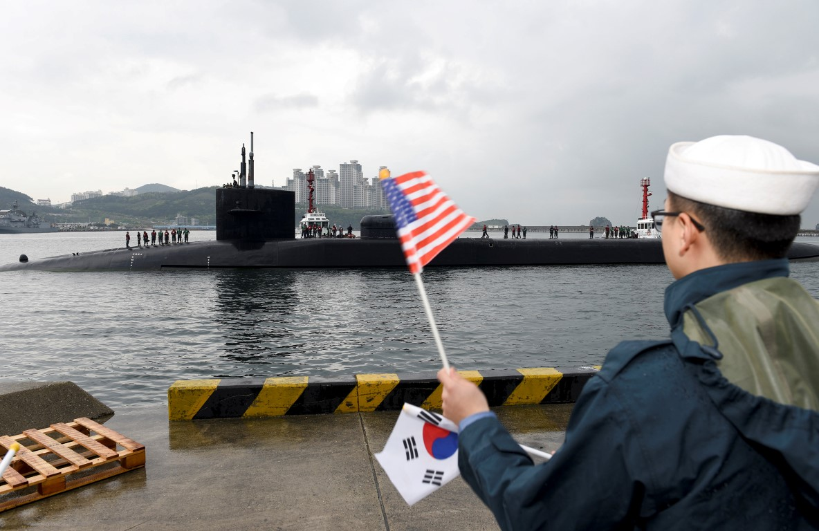 Reports of North Korea artillery drill as US submarine docks in South