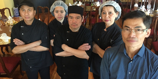Mai Thai Restaurant owner Songvut Manoonpong (right) says his 28-year-old business is threatened...