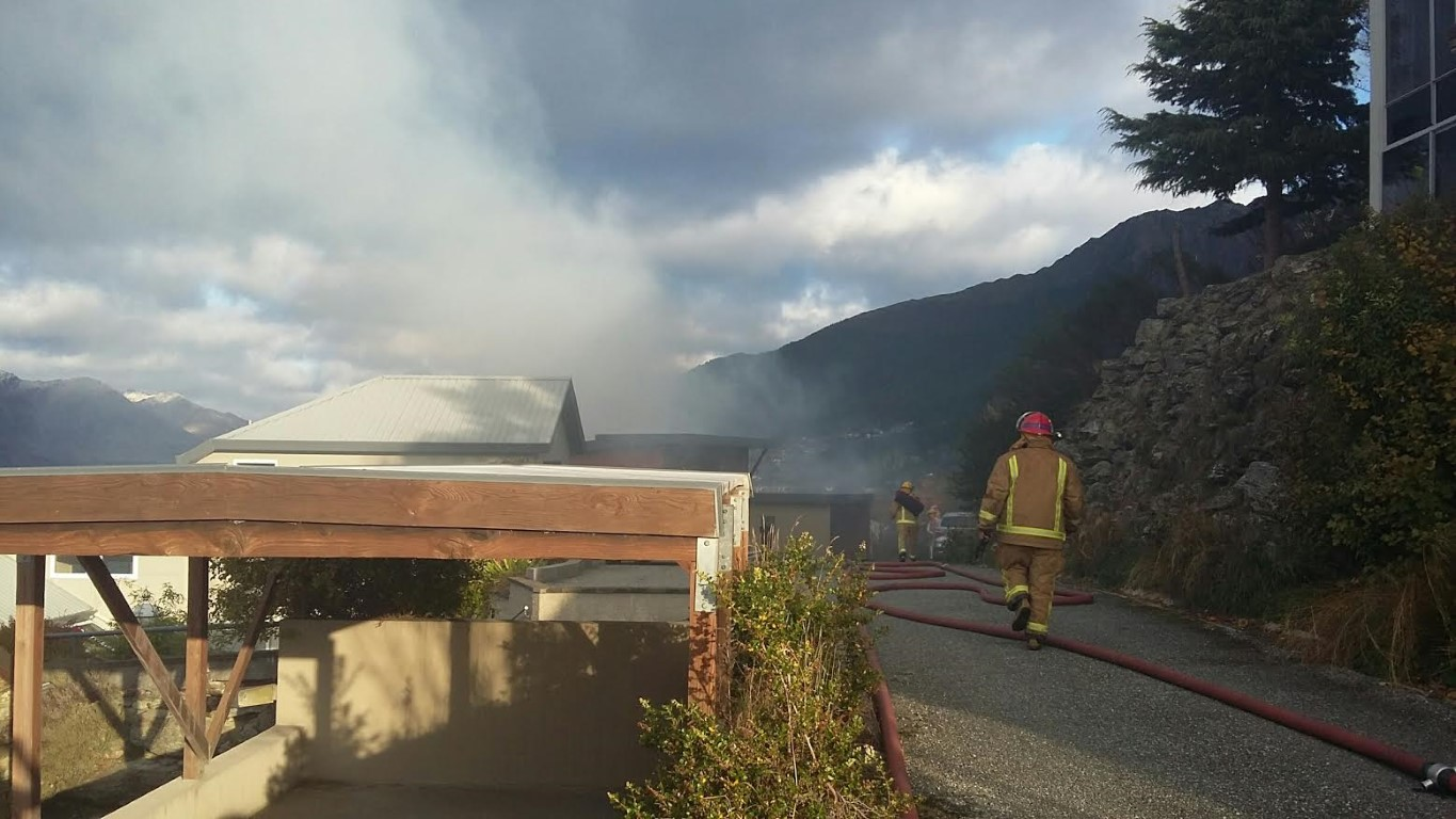 Firefighters at the scene in Queenstown. Photo Louise Scott