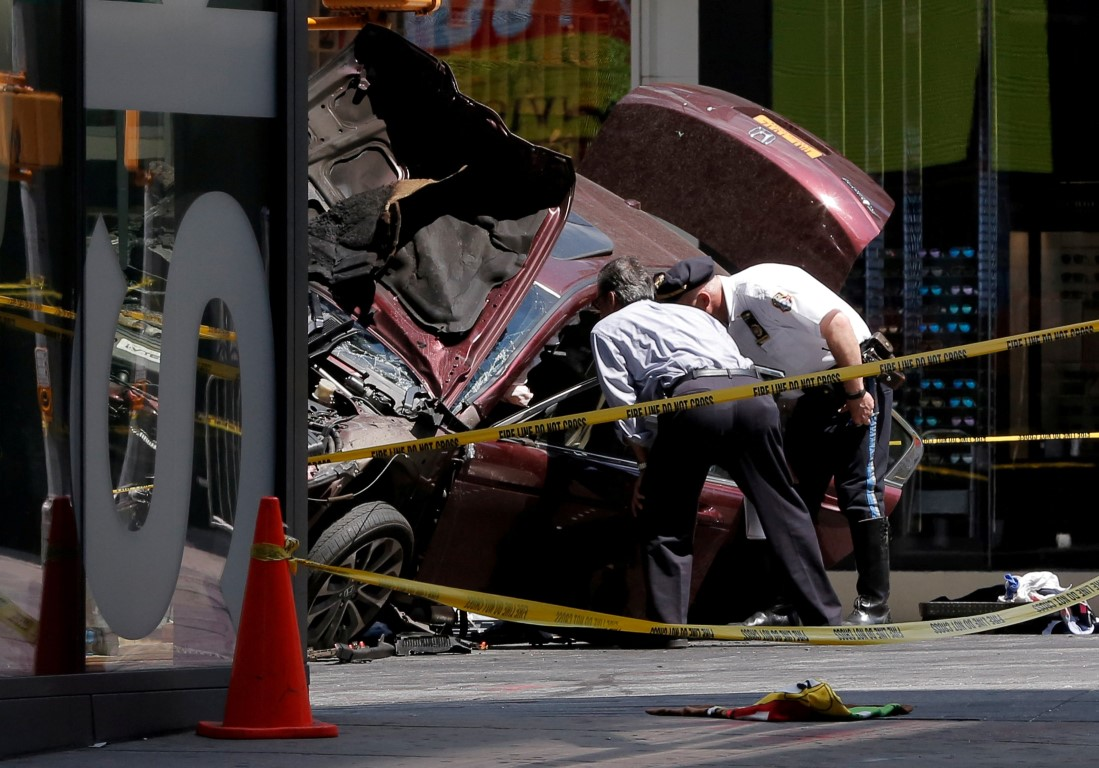Police inspect the vehicle after the incident. Photo Reuters
