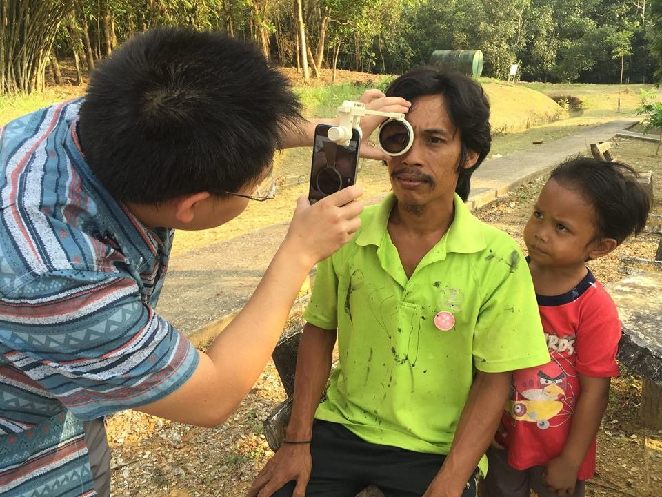 Dunedin's Dr Hong Sheng Chiong checks for eye illness on a patient in Borneo. Photo: supplied.