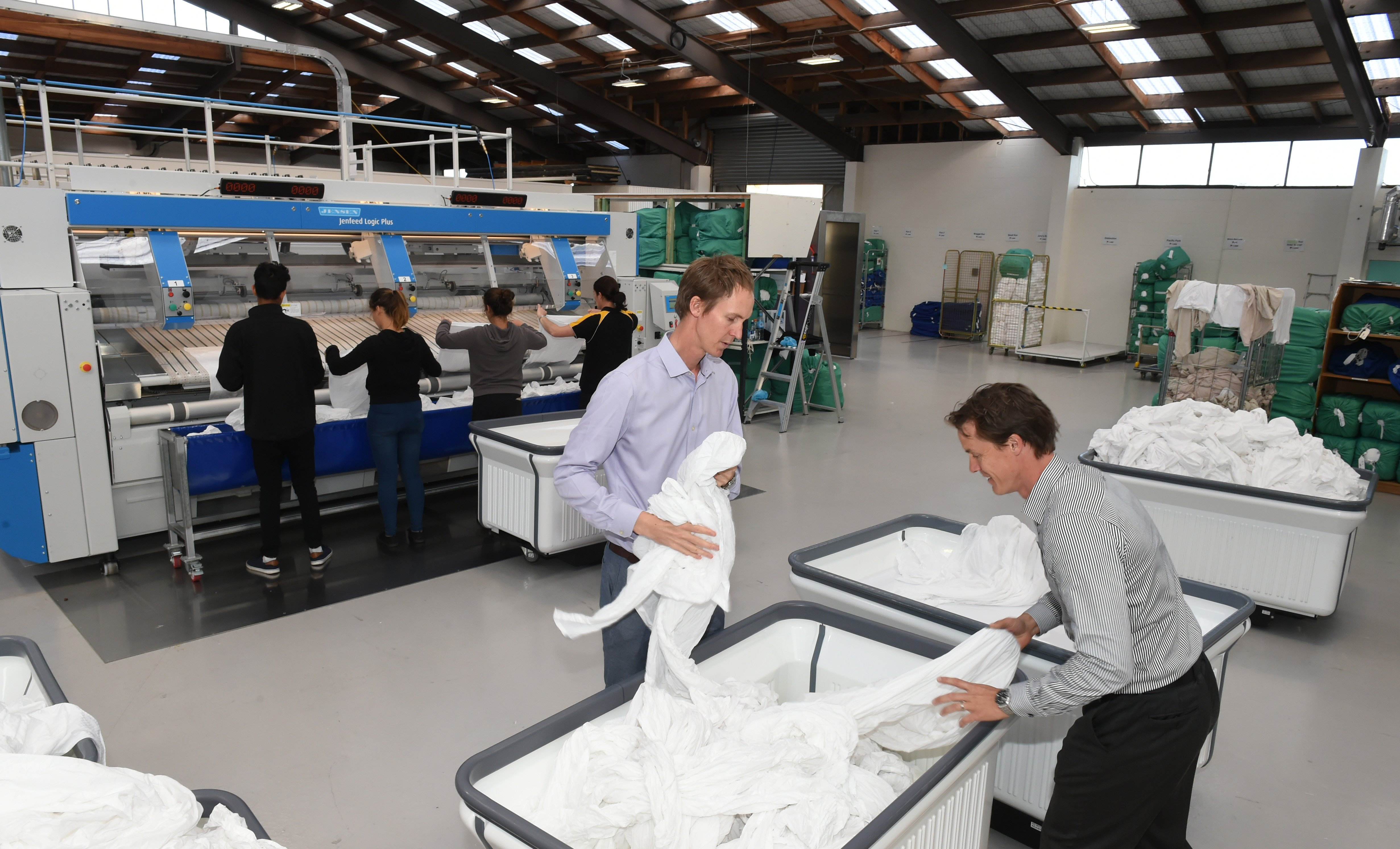 Rick (left) and Steve Wellington prepare sheets to go through a folding machine. Photo: Gregor...