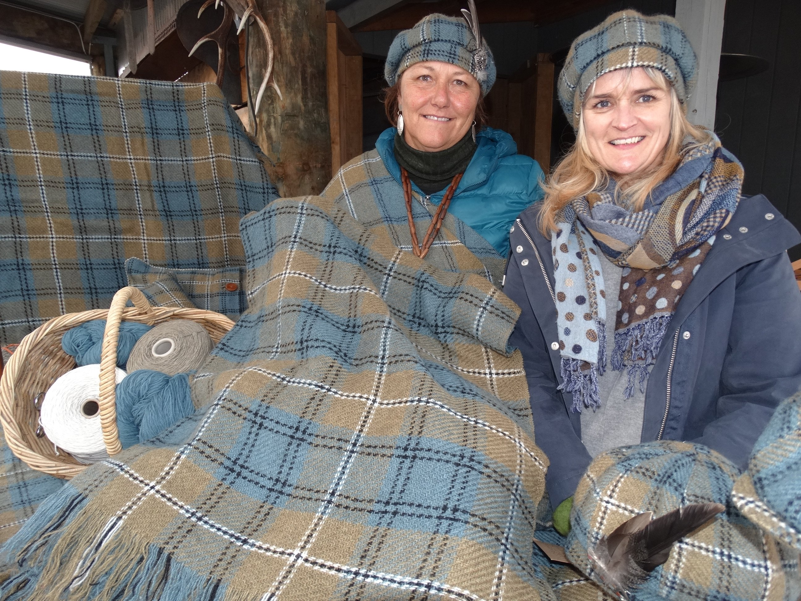 The Southern Lakes tartan was unveiled at the Great Glenorchy Getaway Day by the creator's daughter, Hilary Johnstone (left) at Mrs Woolly's General Store. Also rugged up is Debbie Crompton, the store's general manager. Photo: Louise Scott.