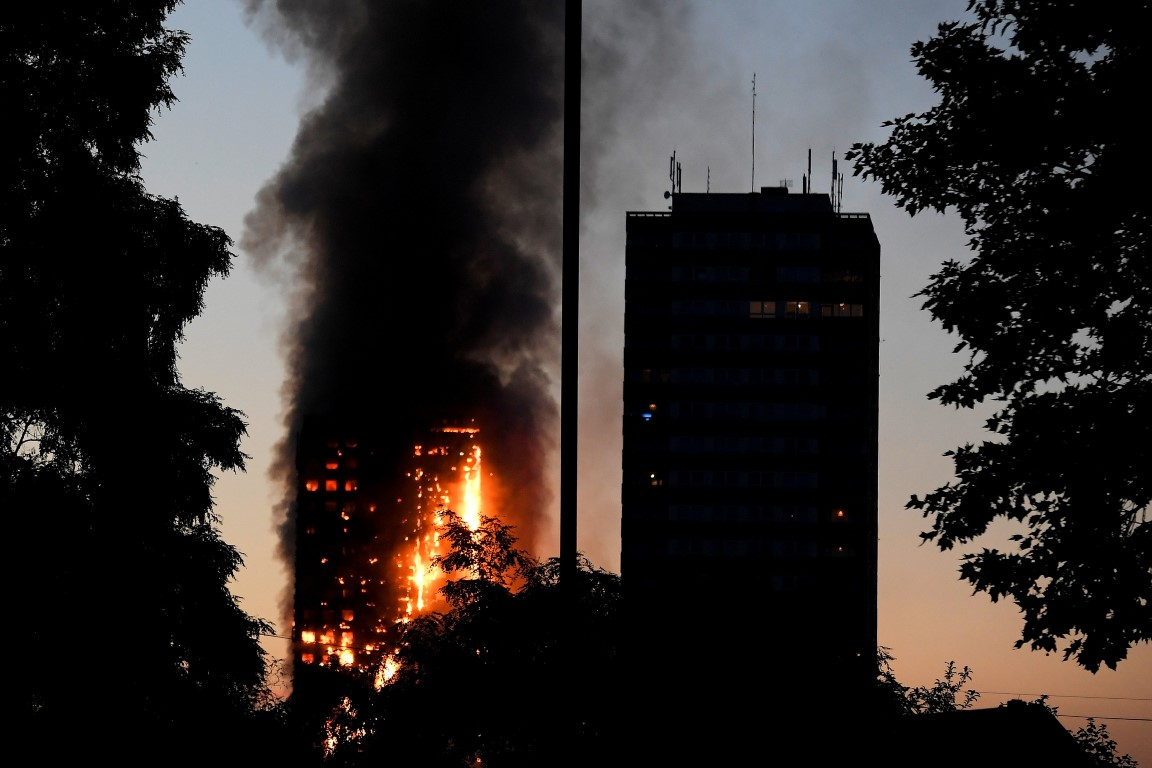 Flames and smoke billow from the tower block at Latimer Road in West London. Photo Reuters