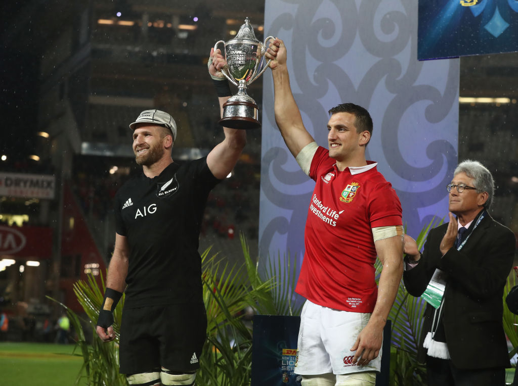 Sam Warburton, (R) the Lions captain, lifts the trophy with Kieran Read, the All Black captain...