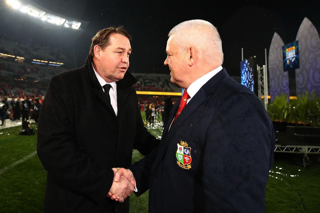 All Black coach Steve Hansen (L) shakes hands with Lions coach Warren Gatland after the match....